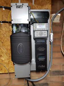 Off-grid Outback FP1 inverter, FM80 charge controller, and Mate3s control panel