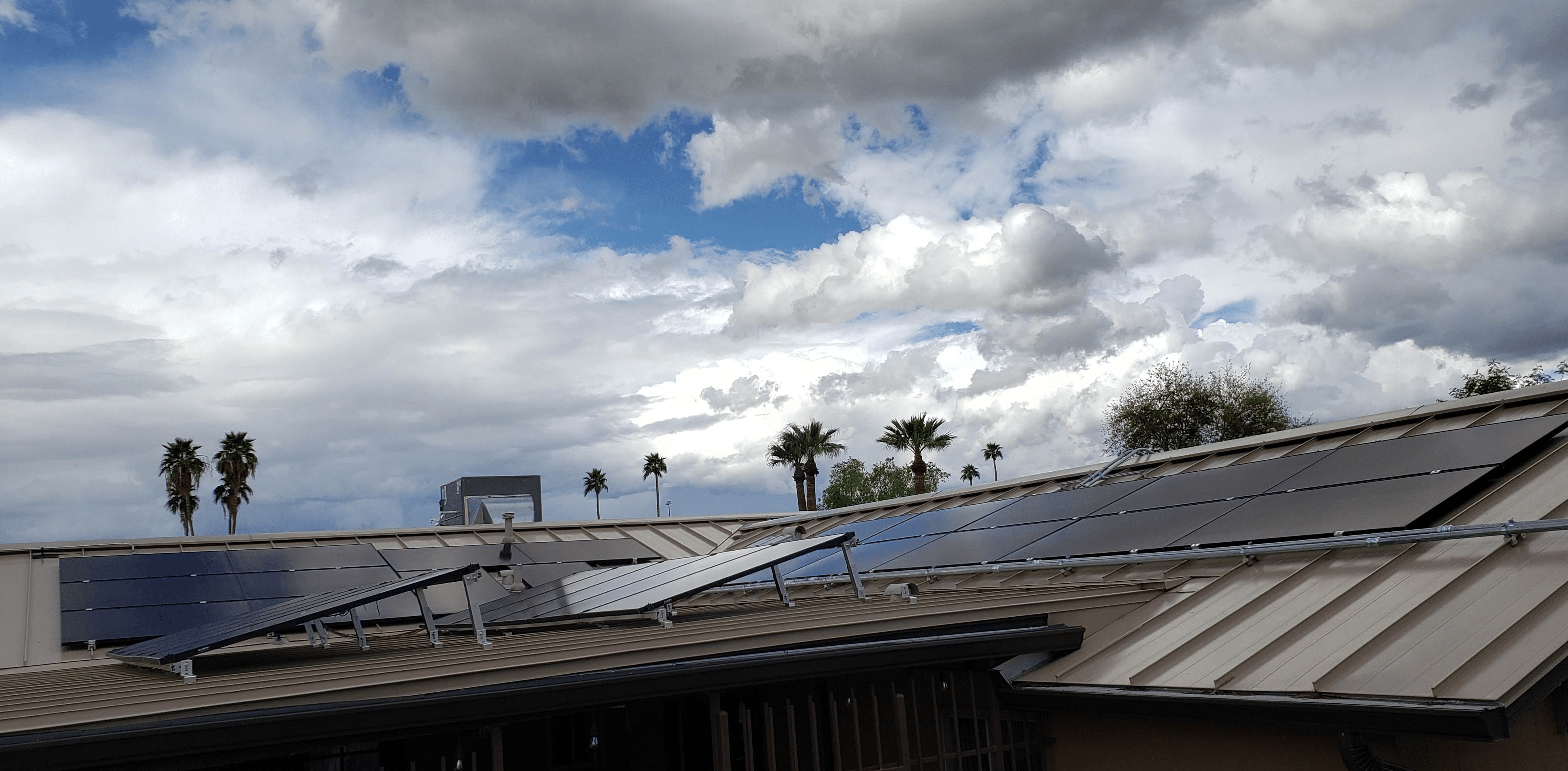 Off-grid solar panels on metal and flat roof in the city with SRP