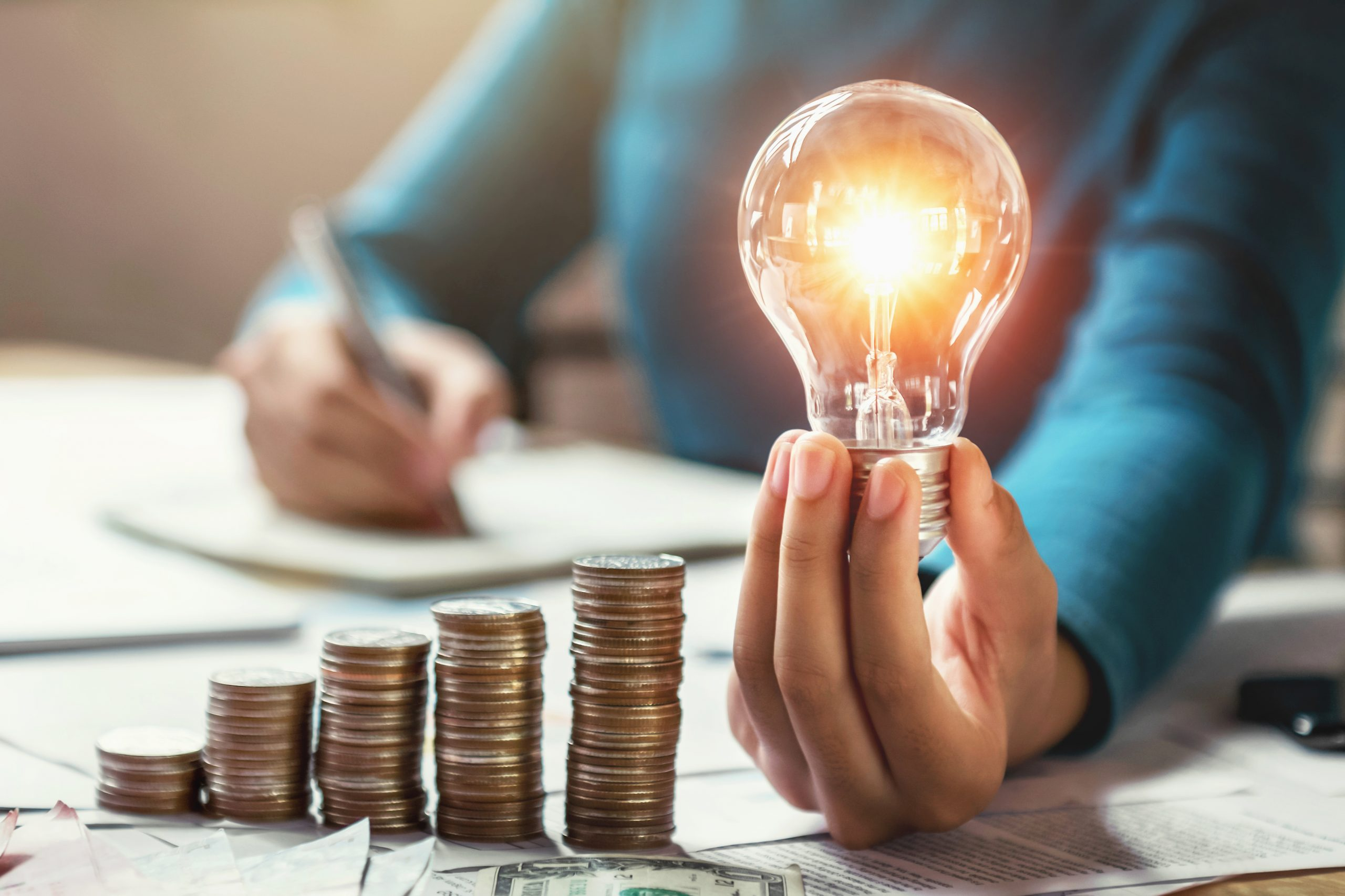 financial incentives concept with increasing coins and lightbulb